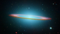 "NASA's Spitzer and Hubble Space Telescopes joined forces to create this striking composite image of one of the most popular sights in the universe. Messier 104 is commonly known as the Sombrero galaxy because in visible light, it resembles the broad-brimmed Mexican hat. However, in Spitzer's striking infrared view, the galaxy looks more like a ""bull's eye.""